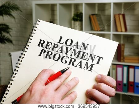 Hand Holds Papers About Loan Repayment Program Lrp.