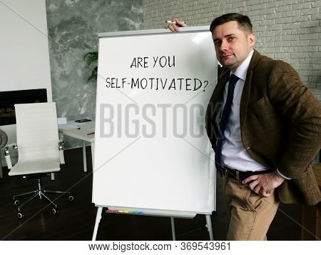 A Man Writes An Inscription Are You Self Motivated? Work Motivation Concept.