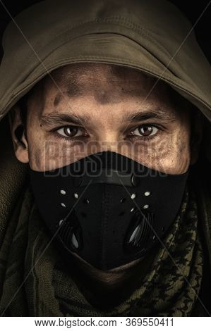 Dark Photo Of Young Handsome Man Wearing Black Protactive Face Mask And Hood