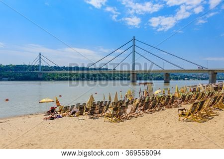 Novi Sad, Serbia - July 3, 2019: People Enjoy On A Beach (strand) On A Danube River, View At Liberty