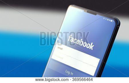 Kyiv, Ukraine-june, 2020: Facebook. Studio Shot Of Smartphone With Facebook Mobile Application On Bl