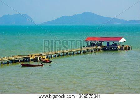 Koh Lanta, Thailand - January, 2014: Pierce On The Andaman Sea On Koh Lanta, Thailand