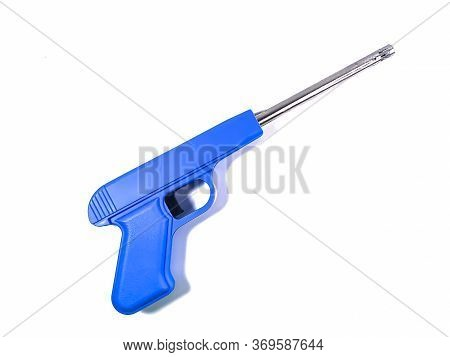 Gun Shaped Electric Spark Lighter With Blue Body Isolated On White Background. Household Lighter For