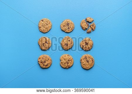 Chocolate Chip Cookies With Brown Sugar, Symmetrically Displayed On Blue Background. Flat Lay With C