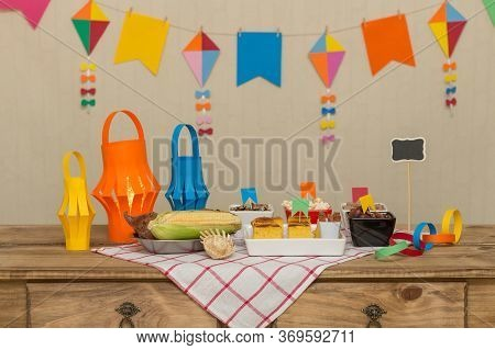 Decorated, Colorful And Cheerful Table With Typical Sweet And Savory Foods To Celebrate The Brazilia