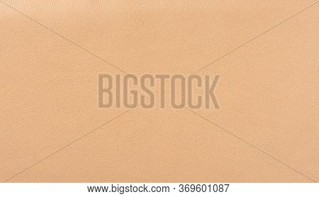 Beige Leather Texture Background. Beige Faux Leather Background. Close Up. Copy Space.