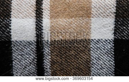 Brown Plaid Blanket. Close Up View Of A Full Size Background Texture. Textile Piece Of Cloth. Warmin