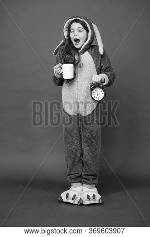 Drinking Coffee Energy. Morning Routines. Adorable Bunny Hold Alarm Clock. Small Girl In Bunny Costu