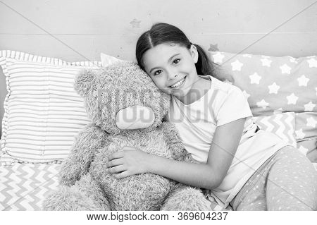 Pure Love Concept. Kids Evening Routines. Favorite Toy. Girl Child Hug Teddy Bear In Her Bedroom. Pl