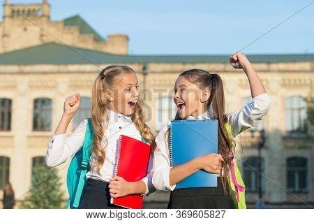 Dare To Win. Happy Winners Celebrate Outdoors. Happy Girls Make Winner Gesture. School Contest Winne