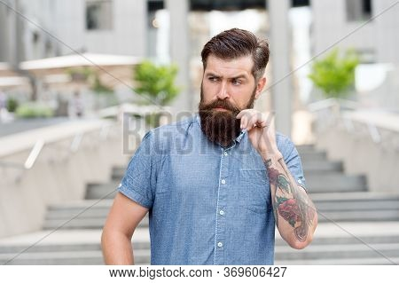 Guy With Beard And Mustache. Barber Salon. Street Style. Walking Down The Street. Mature Hipster Wit