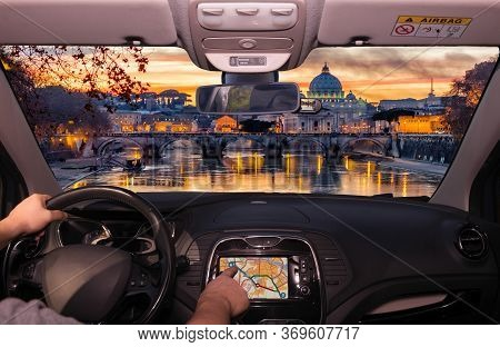 Driving A Car While Using The Touch Screen Of A Gps Navigation System Towards Saint Peter's Church D