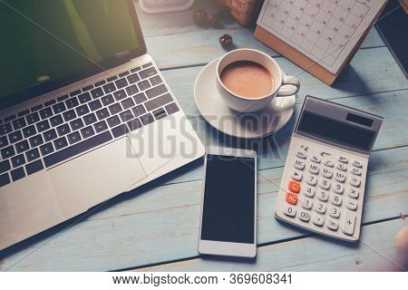 Home Office Desk Concept.laptop And Calculator For Accountant Or Bookkeeper Plan Annual Budget And T