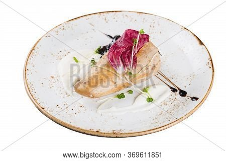 Baked Chicken Breast Served On A Plate With Sauce And Micro-greens. Isolated On A White Background.