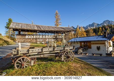 Cortina, Italy - October 27, 2014: Restaurant In Cortina D\'ampezzo With The Sign On The Peasant Wag