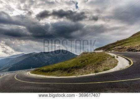 Transalpina Road Serpentines Up Close - Beautiful Mountain Scenery On The Background Viewed From The