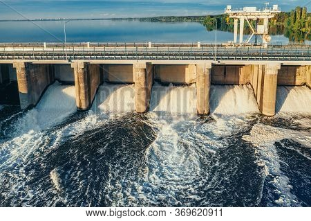 Hydroelectric Dam Or Hydro Power Station At Water Reservoir, Aerial View From Drone. Draining Water