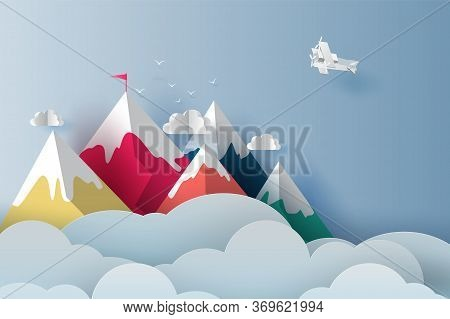 Nature Landscape Plane Flying Over Targeted Top Colorful Mountain With Red Flag On Blue Sky.business