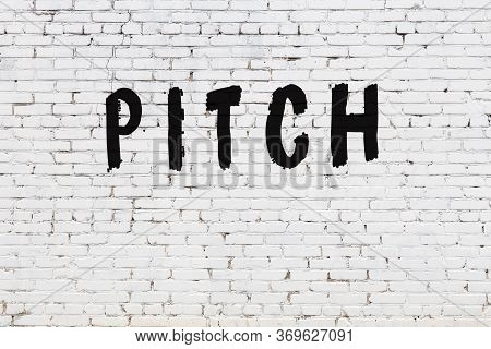 White Brick Wall With Inscription Pitch Handwritten With Black Paint