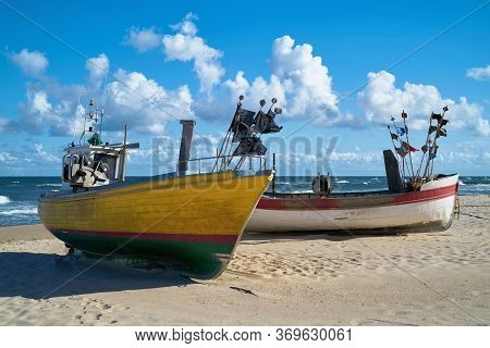 Fishing Boats On The Beach Of The Baltic Sea Near Rewal In Poland