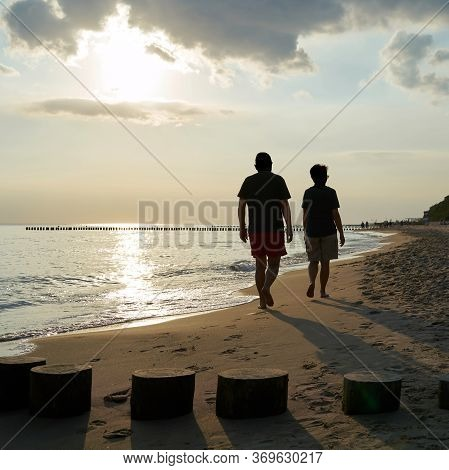 Holidaymakers On The Beach Of The Polish Baltic Sea Near Rewal During A Beach Walk