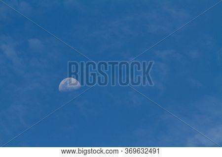 Half Moon On The Blue Sky Background