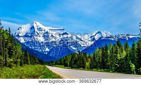 Highway 16, The Yellowhead Highway, Runs Toward The Snow Capped Peak Of Mount Robson, The Highest Pe