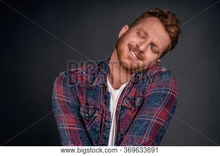 Silly And Funny Caucasian Redhead Guy With Bristle, Tilting Head And Leaning On Shoulder With Lovely