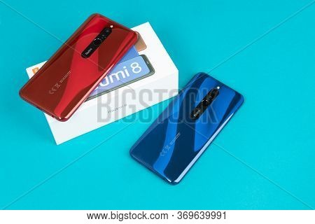 Varna, Bulgaria - May 16 , 2020: The Back Of Xiaomi Redmi 8 Android Smartphones In Ruby Red And Sapp