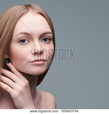 Young Pretty Woman Studio Portrait. Cosmetology Concept. Esthetic Woman Face. Skin Care Dermatology
