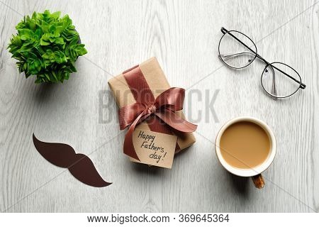 Happy Father's Day Concept. Flat Lay Composition With Gift Box Or Present For Daddy, Mustache, Coffe