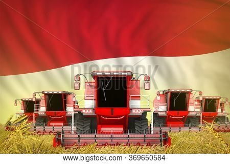Industrial 3d Illustration Of A Lot Of Red Farming Combine Harvesters On Rye Field With Indonesia Fl
