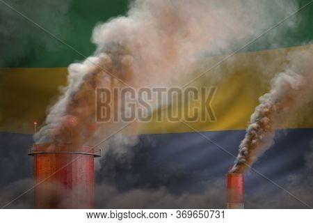 Global Warming Concept - Dense Smoke From Industry Chimneys On Gabon Flag Background With Place For