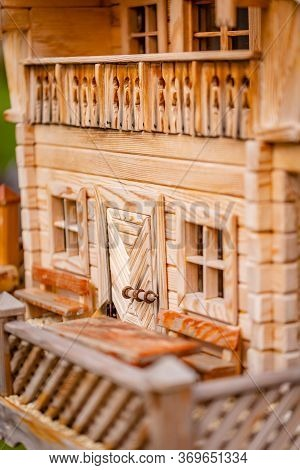 Door And Windows Of A Little Miniature Bird House Designed Like A Apartment Lodge In The Alps