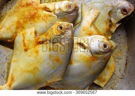Cropped And Close View Of Sea Fish \'pomfret\'.  Fresh Raw Sea Fish Ready To Cook Display With Selec