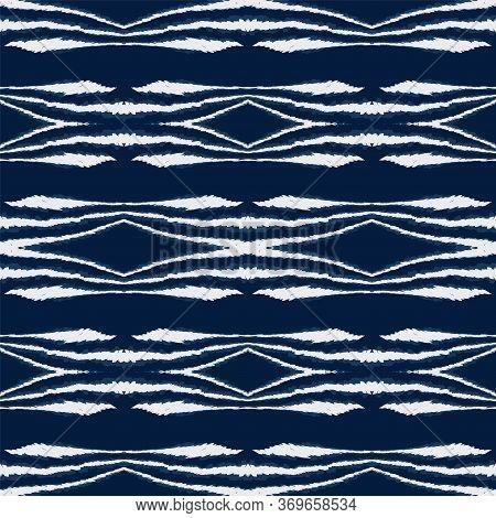 Cold Ikat Ogee Vector Seamless Pattern. Navajo Fabric Batik Background. Geometric African Wallpaper.