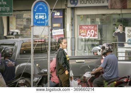 Bangkok, Thailand - June 04: Unnamed Lone Passenger Awaits For Bus Next To A Stop On Petchkasem 69 I