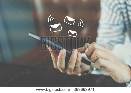 Woman Hand Using Smartphone To Send And Recieve Email.