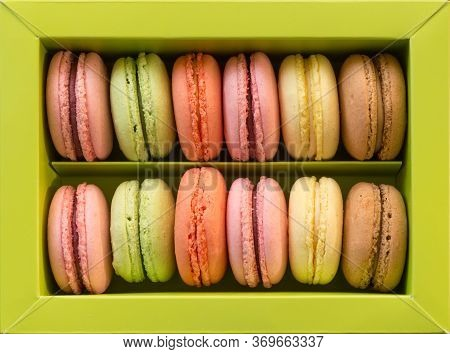 Isolated Green Box Of Colorful Macarons Assortment