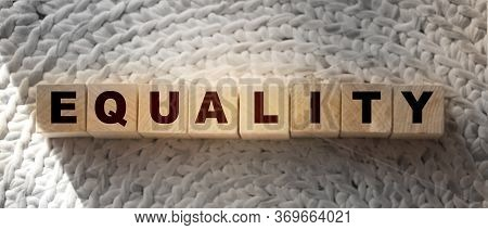 Equality Word On Wooden Cubes Put On Crochet Carpet. Gender And Race Equality, Tolerance For Other R