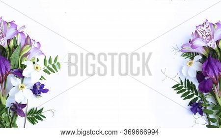 Spring Flower Arrangement - White Daffodils, Lilac Alstroemeria, Purple Irises On A White Background