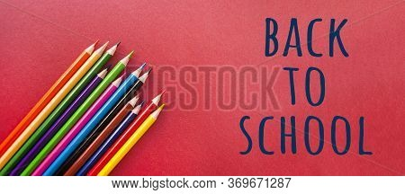 Colorful Pencils On Red Background With Copyspace. Banner With Copyspace.