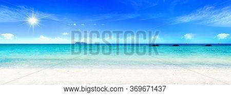 World Oceans Day Concept: Beautiful Beach With White Sand, Turquoise Ocean Water And Blue Sky With C