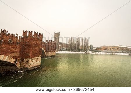 Verona. Ponte Scaligero (medieval Bridge) And Castelvecchio (old Castle) With The River Adige In Win