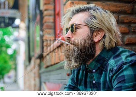 Cigarette. Close Up Portrait Of Smoking Man. Sensual Hipster With Cigarette. Bearded Man Smoke The C