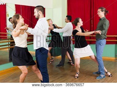 Adult American Men And Women Enjoying Of Tango In Class.
