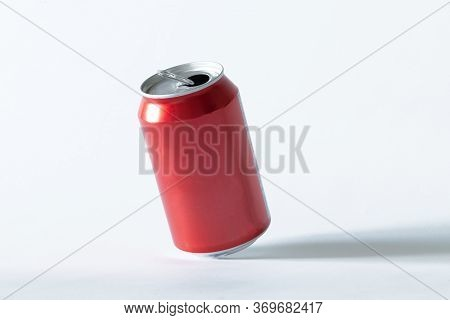 An Opened Can Of Soda Pop On A White Isolated Background. Drink And Recycling Concept.