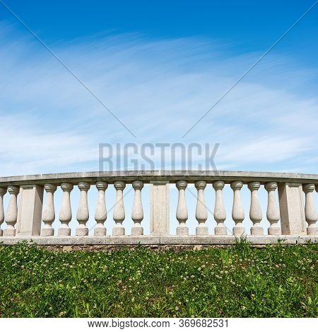 Close-up Of A White Balustrade In Classic Style On Blue Sky With Clouds And Copy Space