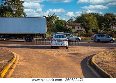 Gaborone, Botswana - May 14 2020: police car at a road block, in Africa ,