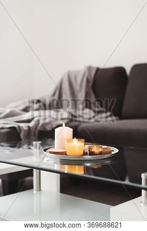 Simple Living Room Decor: Coffee Table With Burning Aroma Candles On A Metal Tray. Hygge Concept. Mi